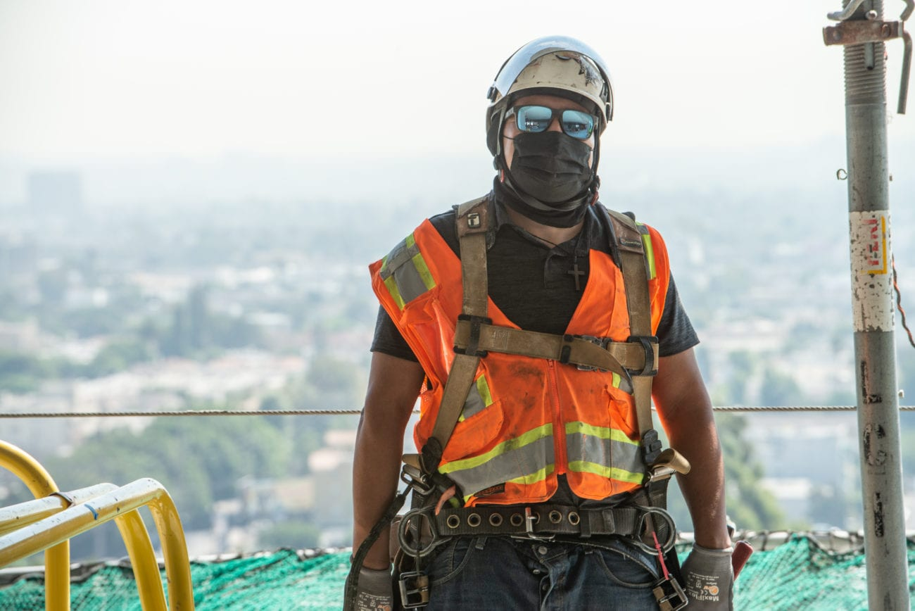 Masked construction worker at the Landmark Apartments